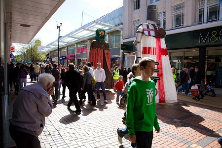 Swindon St. George Statue parading through Swindon town centre