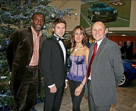 Linford Christie and X-Factor's Dan De Bourg with representatives from Triumph International and Mercedes Benz in Swindon