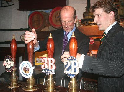 Duke of Kent pulls the first pint at Arkell's brewery in Swindon