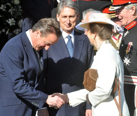 David Cameron bows to the Princess Royal at the Letter Patents ceremony at Royal Wootton Bassett