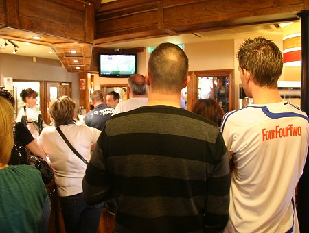 Swindon fans watch the Johnstone's Paint Trophy Final