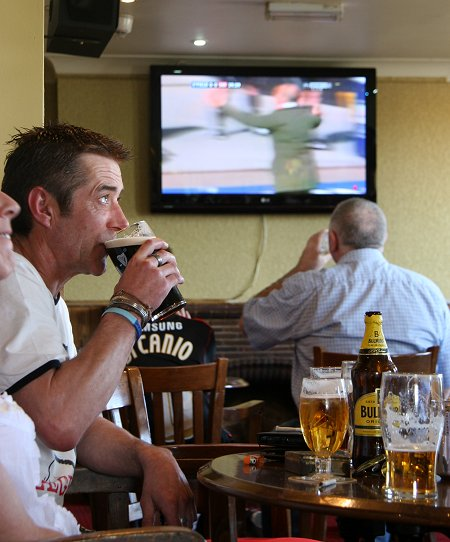 Swindon fans watch the Johnstone's Paint Trophy Final at the New Inn