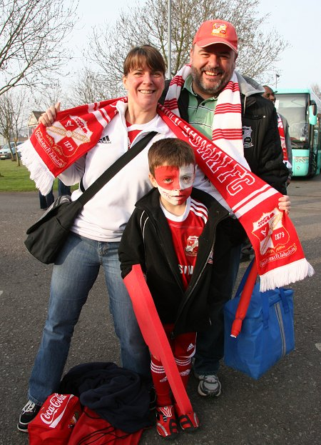 Swindon fans leave for Wembley from the County Ground