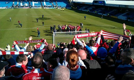 Swindon fans celebrate promotion at Gillingham