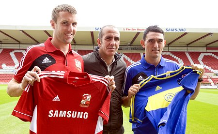 New Swindon signings Gary Roberts (l) and Andy Williams, with Paolo Di Canio