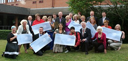 Swindon Rotary Glitter Ball Cheques