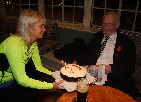 Guinness Jim receives his birthday cake from Verity Brooke-Maples