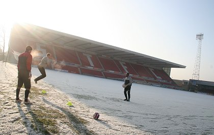 Swindon Town footballers training in the frost at the County Ground