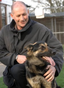 PC Neil Sampson with brave dog Anya