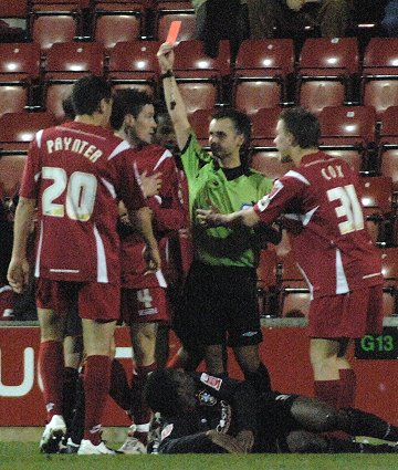 Lee Peacock for Swindon Toen Football Club gets a red card