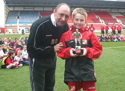Swindon Town manager Maurice Malpas awards 10-year-old Calvin Smith