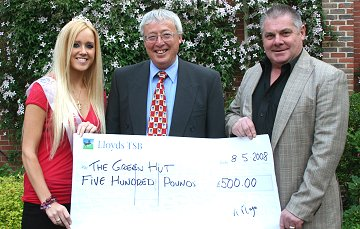 The Green Hut charity receives £500 from KM Promotions in Swindon