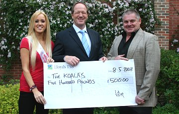 The Koalas receive £500 from KM Promotions in Swindon