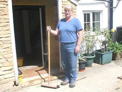 Haydon Wick resident Linda Brown in Swindon clearing up after the floods