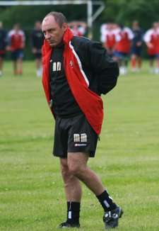 Swindon Town boss Maurice Malpas puts the boys through their paces at pre-season training