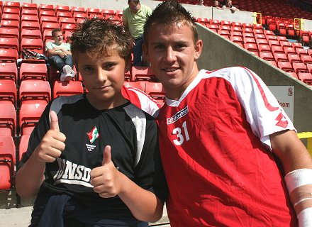 Swindon Town's Simon Cox meets with fans