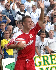 Swindon Town's Simon Cox scores against Leeds United