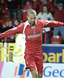 Swindon Town star Christian Roberts retires from football