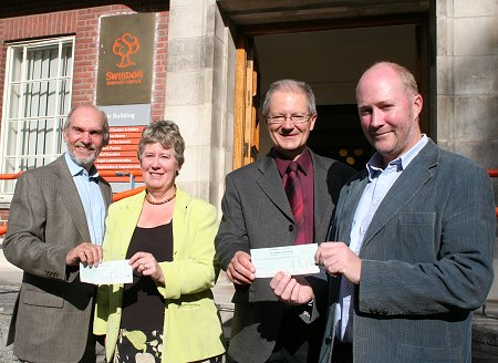 Former Swindon Mayor Michael Banrnes presents cheques to Swindon Cares and TWIGS