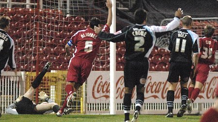 Simon Cox scores the second for Swindon Town