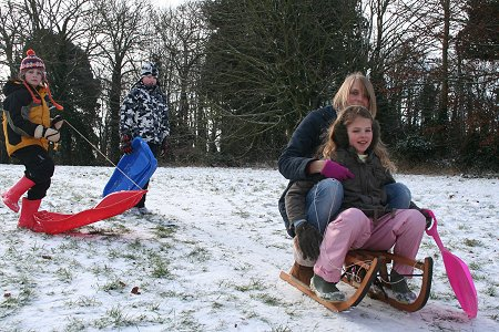 Sledging on the Lawn, Old Town, Swindon