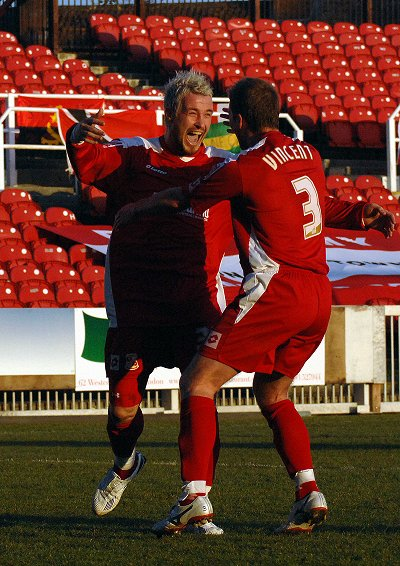 Lee Peacock celebrates after scoring the final goal in Swindon Town's 4-2 win against Scunthorpe