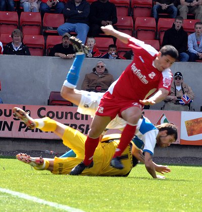 Byron Anthony takes a tumble during Swindon Town v Bristol Rovers 25 April 2009