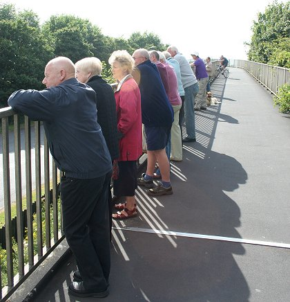 Crowds gather on the Gablecross walkway in Stratton St Margaret, Swindon