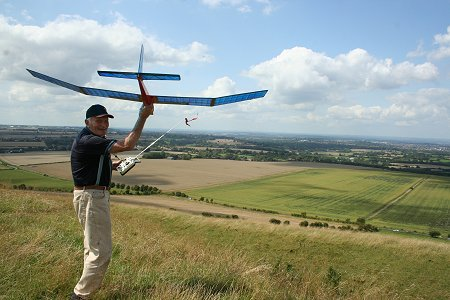 Ron Glover launches his model aircraft on Liddington Hill