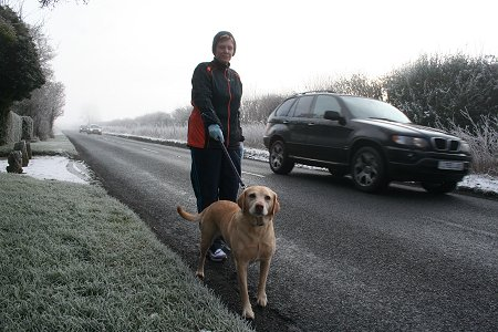 Lady walking her dog on the A361, Swindon, frosted over 2009