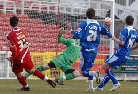 Charlie Austin scores for Swindon against Carlisle