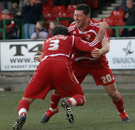 Billy Paynter and Alan Sheehan celebrate scoring Swindon's first