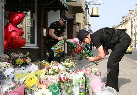 Police clear Sian flowers at Suju