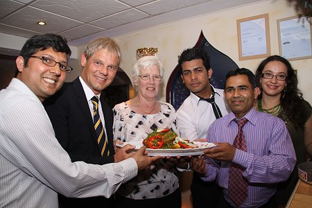 Salzgitter mayor Frank Klingebiel and family with Swindon major Ray Ballman at The Curry Place, Rodbourne, Swindon
