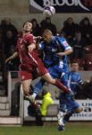 Ex-Orient player, now Town defender, Craig Easton wins a header